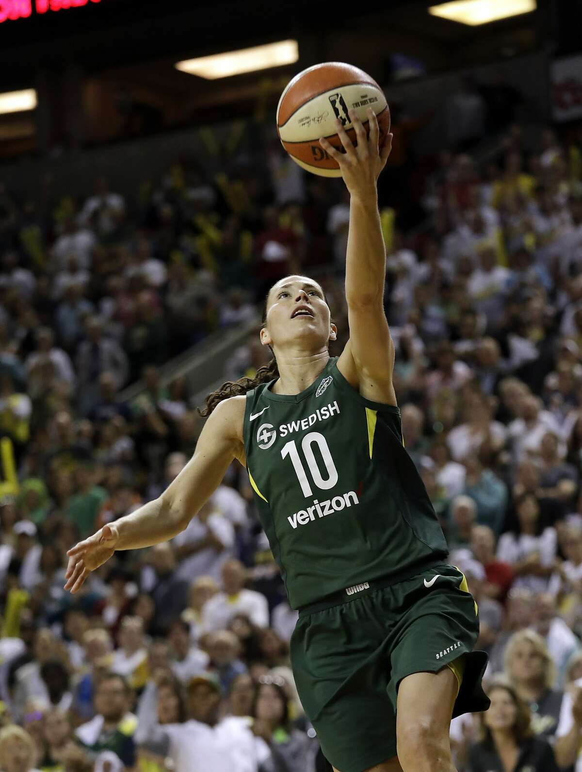 Seattle Storm's Sue Bird drives the lane to score late in overtime in a WNBA basketball playoff semifinal against the Phoenix Mercury, Tuesday, Aug. 28, 2018, in Seattle. The Storm won 91-87 in overtime. (AP Photo/Elaine Thompson)