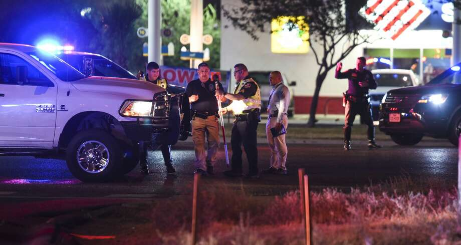 The Laredo Police Department's CRASH team surveys the scene of a fatal auto-pedestrian incident on Tuesday, Aug. 28, 2018, at the corner of Mines and Bristol roads. Photo: Danny Zaragoza/Laredo Morning Times