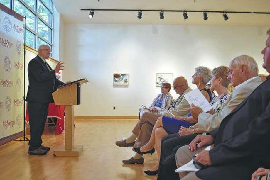 Dr. Charles Sheaff, president of Jacksonville Promise, speaks Tuesday at the Jacksonville Promise scholarship awards ceremony at MacMurray College's Putnam-Springer Center. Photo: Greg Olson | Journal-Courier