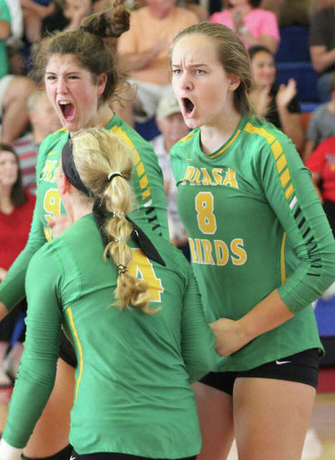 Southwestern's Korrie Hopkins (8) and Bailey Sorgea (back) celebrate a point with teammate Bri Roloff during Saturday's play at the Roxana Tourney. The Piasa Birds stayed unbeaten Tuesday with a three-set win over EA-WR that gave Southwestern is best-ever start to a season at 6-0. Photo: Greg Shashack / The Telegraph