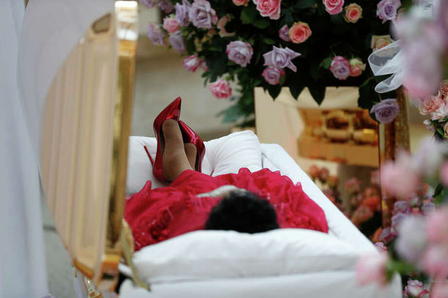 Aretha Franklin lies in her casket at Charles H. Wright Museum of African American History during a public visitation in Detroit, Tuesday, Aug. 28, 2018. Franklin died Aug. 16, of pancreatic cancer at the age of 76. (AP Photo/Paul Sancya, Pool) Photo: Paul Sancya/AP / Copyright 2018 The Associated Press. All rights reserved