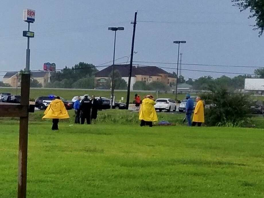 Officials investigate the report of a body found in a canal near Washington Blvd. and Interstate 10 Wednesday, August 29, 2018.