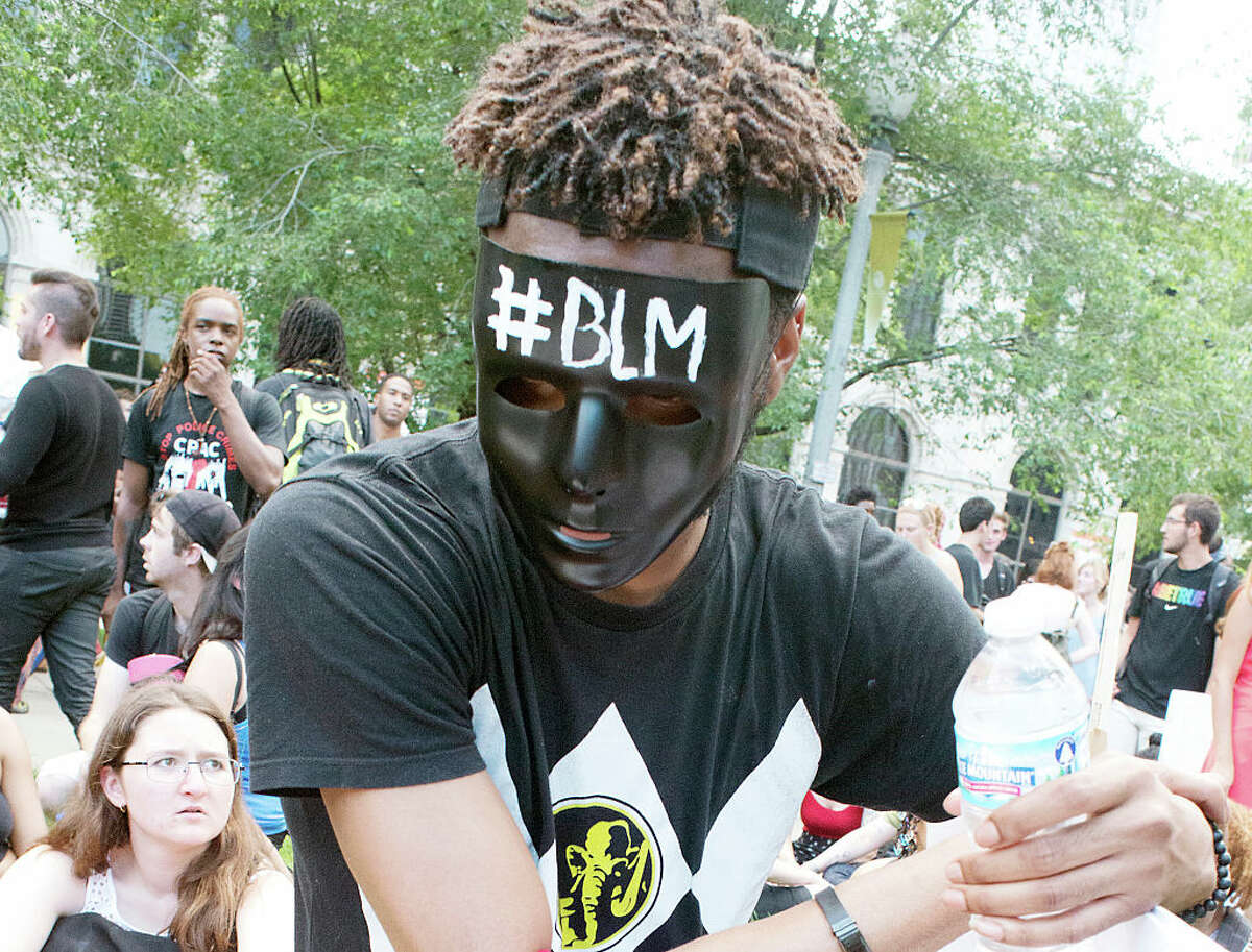 12. Illinois 18 people have been shot and killed by police in 2018  In this photo: Close-up of an unidentified demonstrator in a black mask with '(hashtag) BLM' written on it during a 'Black Lives Matter' protest, Chicago, Illinois, July 11, 2016.