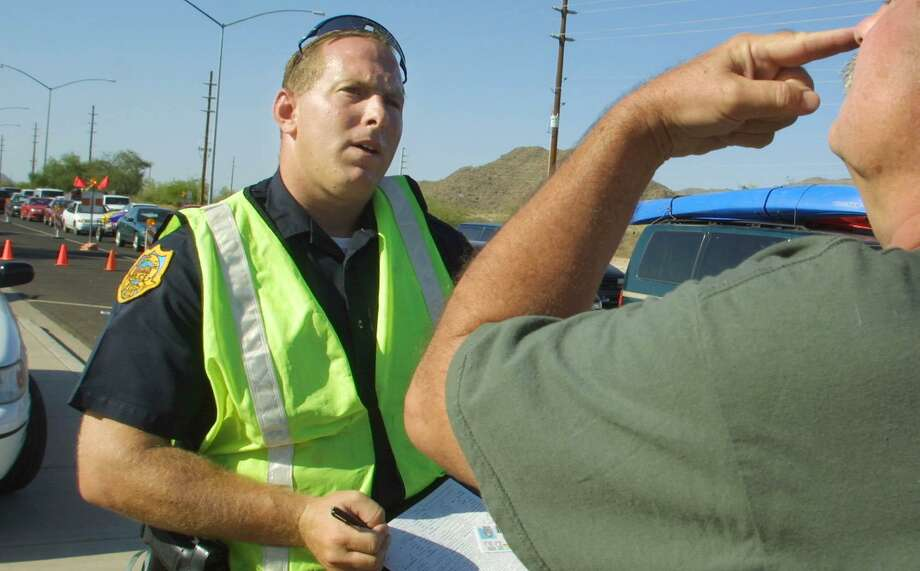An officer conducts a field sobriety test on a motorist. Photo: File Photo / THE ARIZONA REPUBLIC