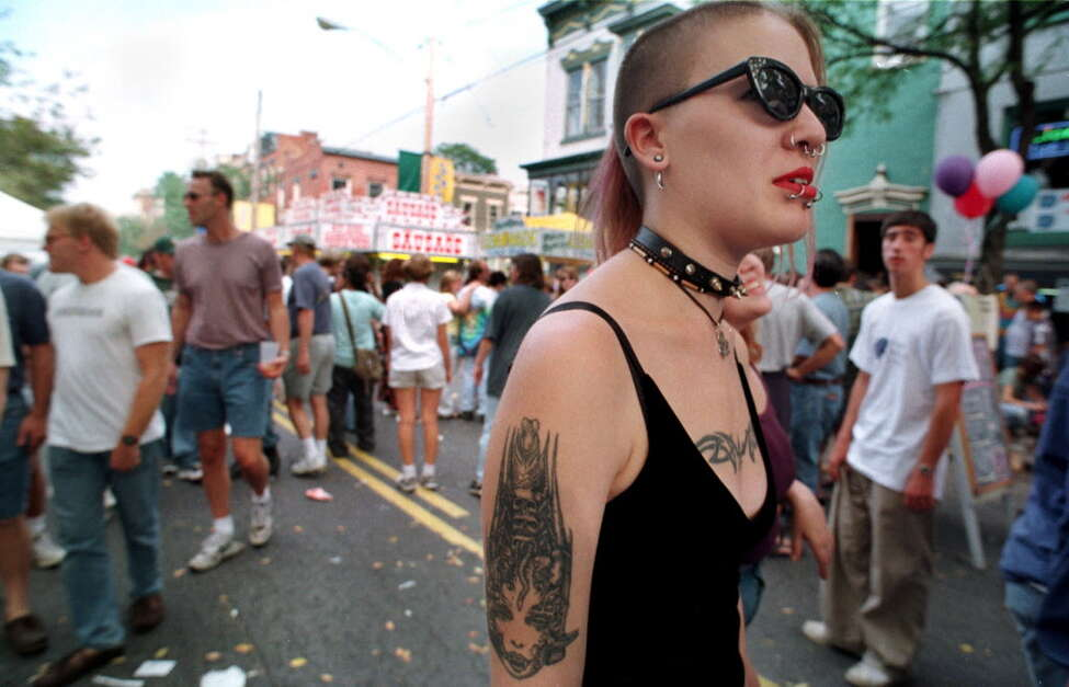 Click through the slideshow to see who our photographers caught on camera in the fall of 1998. SAT. SEPT. 26, 1998 - Kim Wheeler of Albany strolls through the crowded streets during Larkfest, the annual Lark Street block party.
