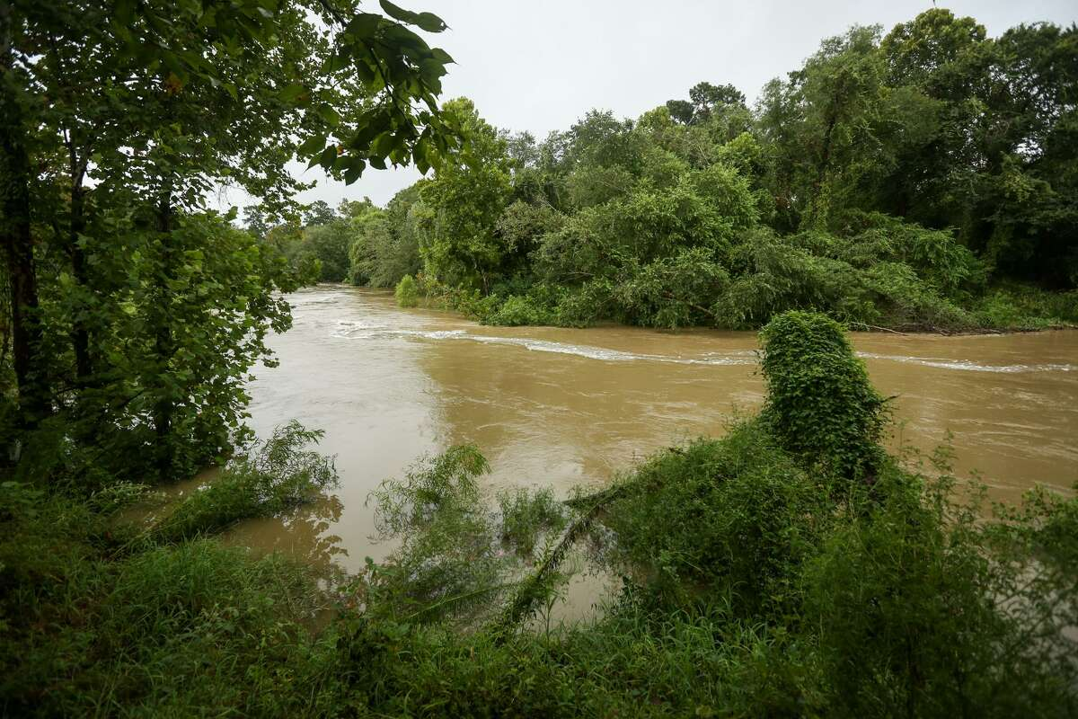 Spring Creek, pictured near Montgomery County Preserve, rises with rains from Hurricane Harvey on Saturday, Aug. 26, 2017, in Spring in this file photo. The $2.5 billion Harris County Flood Control District bond, which passed on the one year anniversary of Hurricane Harvey, includes projects like right-of-way land acquisition and a potential reservoir that could benefit Montgomery County and The Woodlands residents.