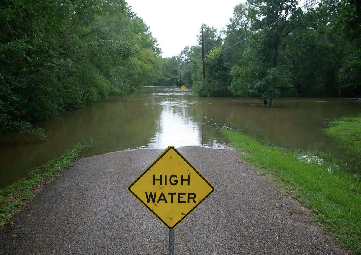 High water is seen around a street sign on Hilltop Hollow in the Timber Lakes sub division of The Woodlands. The $2.5 billion Harris County Flood Control District bond, which passed on the one year anniversary of Hurricane Harvey, includes projects like right-of-way land acquisition and a potential reservoir that could benefit Montgomery County and The Woodlands residents.
