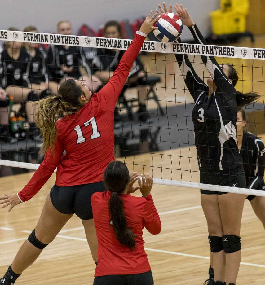 Noemi Marquez blocks the ball Tuesday at Permian Field House. Permian defeated Sweetwater 25-23, 25-20 and 25-18. Photo: Jacy Lewis/191 News