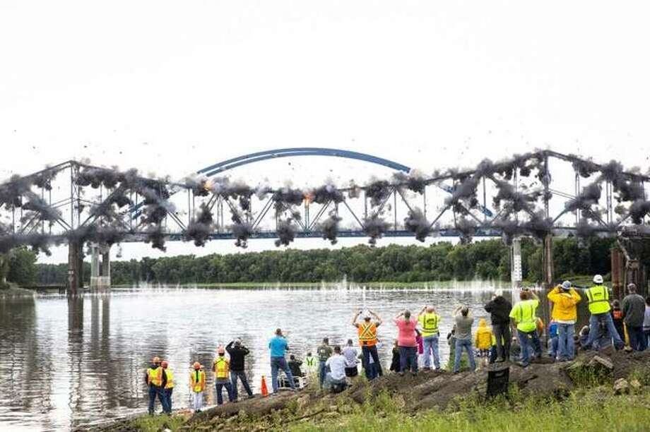 The old bridge carrying Illinois 104 over the Illinois River at Meredosia,Ill. falls into the river after being imploded Wednesday, Aug. 29, 2018 in Meredosia, Ill. The bridge, which opened in 1936, was replaced by new span this summer. Photo: Rich Saal | The State Journal-Register Via AP