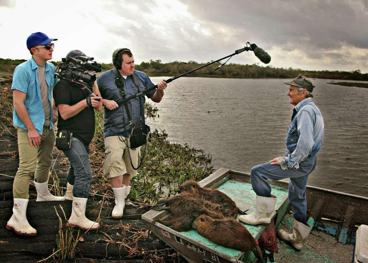Bay Area filmmakers Quinn Costello (left), Jeff Springer and Chris Metzler interview Louisiana nutria hunter Thomas Gonzalez in the documentary