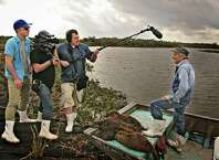 """Bay Area filmmakers Quinn Costello (left), Jeff Springer and Chris Metzler interview Louisiana nutria hunter Thomas Gonzalez in the documentary """"Rodents of an Unusual Size."""""""