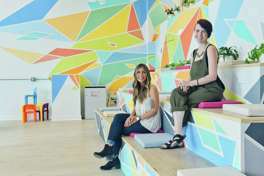 Sarah Johnston, left, director of operations for CoLab and Stacks Espresso Bar and Katie McKenna, community manager for CoLab, pose for a photo inside the CoLab space on Wednesday, July 25, 2018, in Albany, N.Y.   (Paul Buckowski/Times Union) Photo: Paul Buckowski / (Paul Buckowski/Times Union)