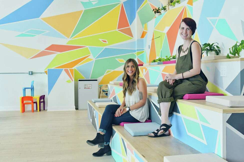 Sarah Johnston, left, director of operations for CoLab and Stacks Espresso Bar and Katie McKenna, community manager for CoLab, pose for a photo inside the CoLab space on Wednesday, July 25, 2018, in Albany, N.Y. (Paul Buckowski/Times Union)