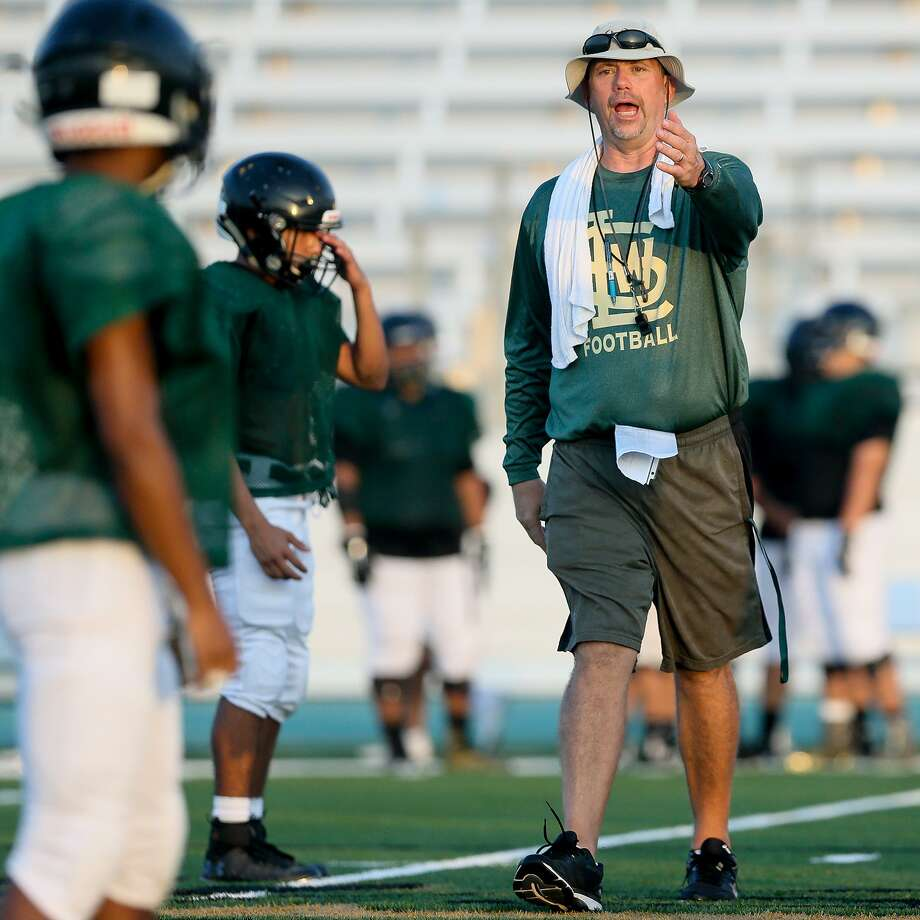 Southwest Legacy head coach John Tarvin works with the Titans during a morning practice session at the school on Saturday, Aug. 18, 2018. Photo: Marvin Pfeiffer /Staff Photographer / Express-News 2018