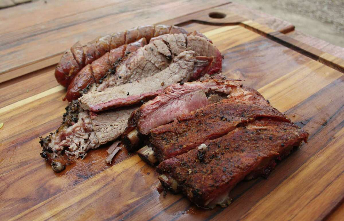 The trinity at B-Daddy's Barbecue includes two kinds of beef sausage (original and jalapeno), brisket and pork loin spare ribs.