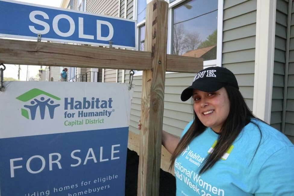 Capital District Habitat for Humanity home buyer Yahaira at the her house, which a crew volunteers from CD Habitat's Women Build 2018 volunteers helped to construct. (Capital District Habitat for Humanity)