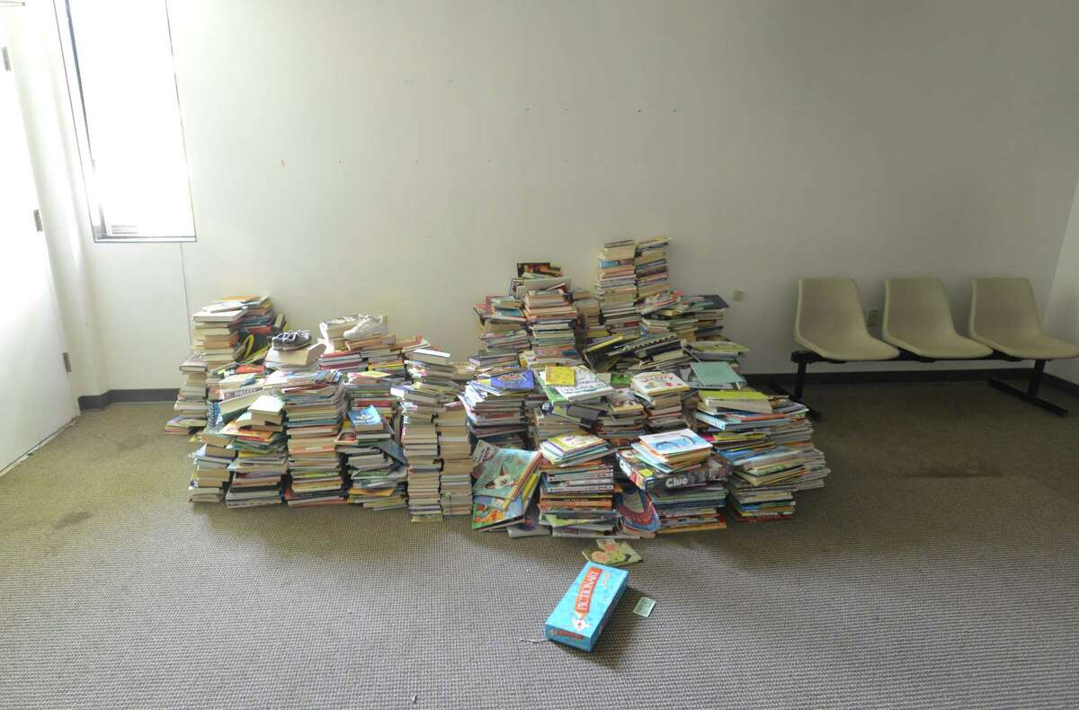 Books are piled in an empty room at the South Norwalk Community Center on Wednesday August 29, 2018 in Norwalk Conn. The Common Council has authorized the city to purchase the remaining half interest in the building at 98 South Main St. from South Norwalk Community Center, Inc.