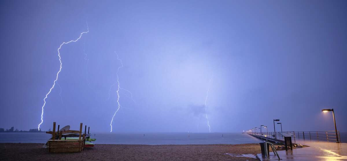This photo captures lightning bolts striking near the Harbor Beach area during a past storm. Thunderstorms are likely Tuesday afternoon in the Thumb, but are not expected to be severe. (Tribune File Photo)