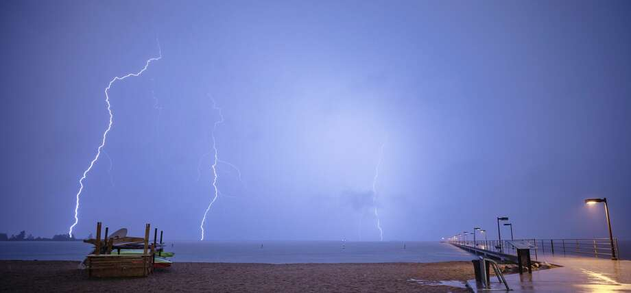 This photo captures lightning bolts striking near the Harbor Beach area during Tuesday night's storm. According to the National Weather Service, today's forecast is calling for sunny skies and highs in the upper 60s. Photo: Photo Courtesy Of Clark Ramsey