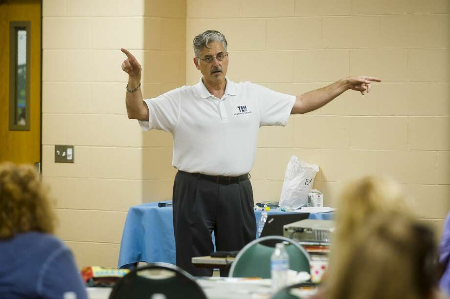FILE — Sam Price, president and CEO of Ten16 Recovery Network, speaks during a free training session for Naloxone and Narcan, drugs that are used to reverse an opioid overdose, on Tuesday, Aug. 28, 2018 at the Greater Midland North Family Center. (Katy Kildee/kkildee@mdn.net, File) Photo: (Katy Kildee/kkildee@mdn.net)