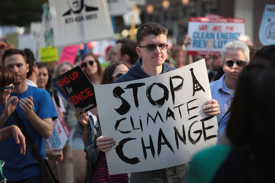 CHICAGO, IL - JUNE 02: Demonstrators protest President Donald Trump's decision to exit the Paris climate change accord on June 2, 2017 in Chicago, Illinois. Yesterday, in a speech from the Rose Garden, Trump announced that the United States would no longer honor the agreement, stating it imposed unfair standards on American businesses and workers. (Photo by Scott Olson/Getty Images) Photo: Scott Olson / Getty Images