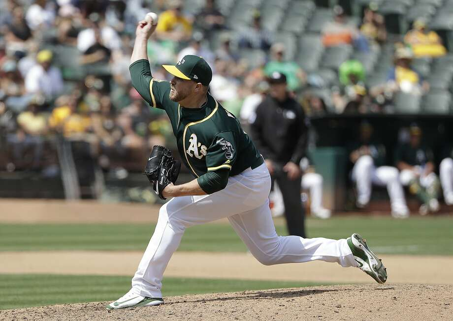 Oakland Athletics pitcher Shawn Kelley throws against the Texas Rangers during a baseball game in Oakland, Calif., Wednesday, Aug. 22, 2018. (AP Photo/Jeff Chiu) Photo: Jeff Chiu, Associated Press