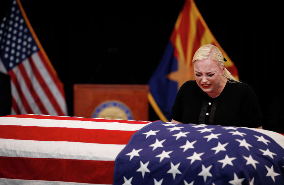 Meghan McCain, daughter of Sen. John McCain, touches the casket during a memorial service at the Arizona Capitol on August 29, 2018, in Phoenix, Arizona. John McCain will lie in state at the Arizona State Capitol before being transported to Washington D.C. where he will be buried at the U.S. Naval Academy Cemetery in Annapolis. Sen. McCain, a decorated war hero, died August 25 at the age of 81 after a long battle with Glioblastoma, a form of brain cancer. (Photo by Jae C. Hong - Pool/Getty Images) Photo: Pool/Getty Images / 2018 Getty Images