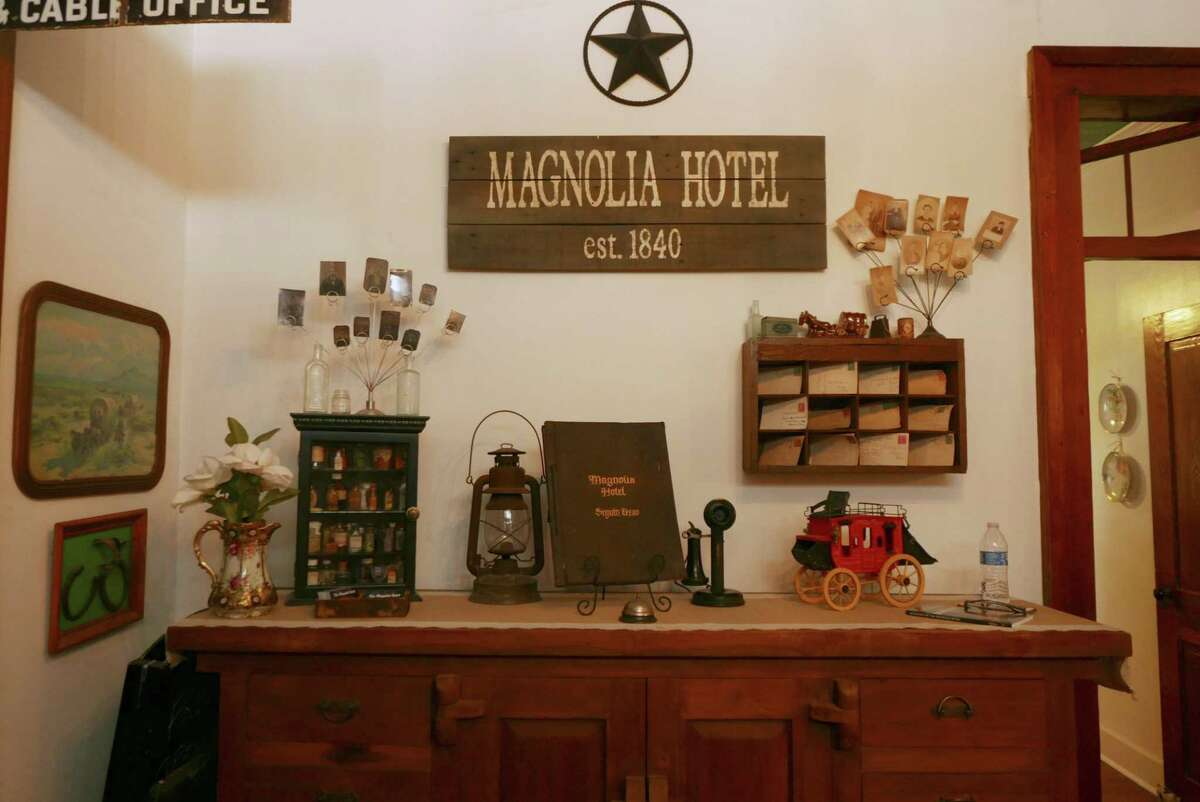 The entrance to the Magnolia Hotel in Seguin is decorated with items, many dating to the 1800s, found on the property.