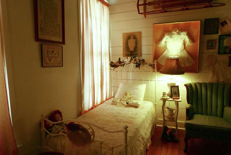 The ghost of several children are said to inhabit this room in the Magnolia Hotel, according to owners Erin O. Wallace-Ghedi and her husband Jim Ghedi, including 12-year-old Emma Voelcker, killed while sleeping in her New Braunfels home in the early morning hours of July 23, 1874. Photo: Billy Calzada /Staff Photographer / San Antonio Express-News