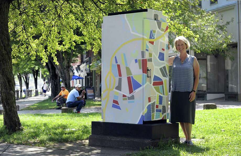 Toni Miraldi of Newtown stands with the artwork that she designed for a traffic box at the corner of Main and Elm Streets in Danbury, Wednesday, August 29, 2018. Photo: Carol Kaliff / Hearst Connecticut Media / The News-Times