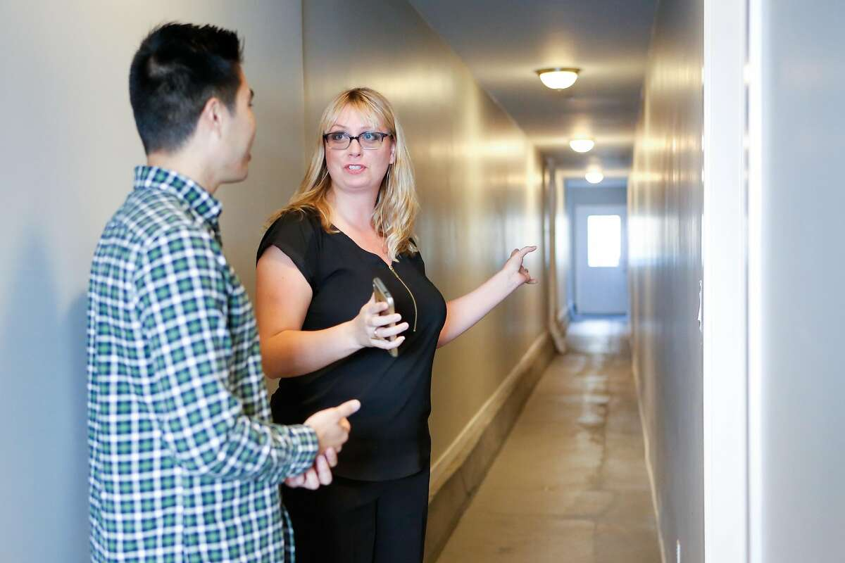 Derek Flores and architect Serina Callhoun point out the regress hallway that the fire department required they included in the Richmond area on Wednesday, August 29, 2018 in San Francisco, Calif. That requirement was the result of inconsistent fire code reviews and is what the city hopes to streamline in it's new ADU permitting process.