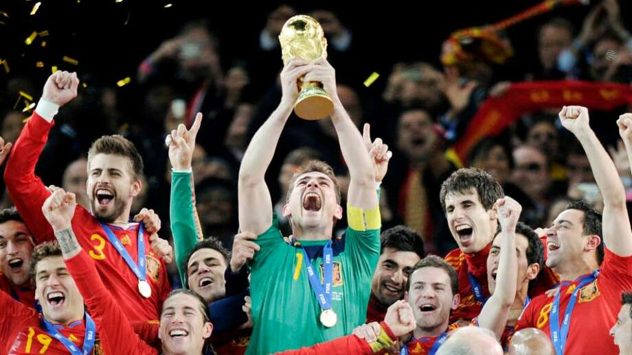 Spain goalkeeper Iker Casillas holds up the World Cup trophy after the World Cup final soccer match between the Netherlands and Spain at Soccer City in Johannesburg, South Africa, Sunday, July 11, 2010. Spain won 1-0. (AP Photo/Martin Meissner) Photo: Martin Meissner, AP / AP 2010