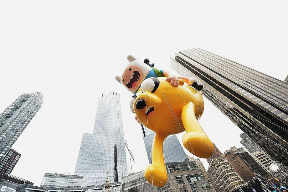 NEW YORK, NY - NOVEMBER 27:  The Finn 'n Jake Adventure Time balloon passes by during the 88th annual Macy's Thanksgiving Day Parade on November 27, 2014 in New York City. Over 8,000 people took part in the parade and it is estimated that over three million people were in attendance.  (Photo by Michael Loccisano/Getty Images) Photo: Michael Loccisano, Getty Images