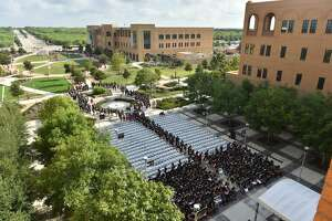 """Incoming Texas A&M San Antonio freshmen take their seats earlier this month after walking the """"Miracle Mile"""" from the Torre de Esperanza to the fountain where they were greeted by upperclassmen, faculty and staff."""