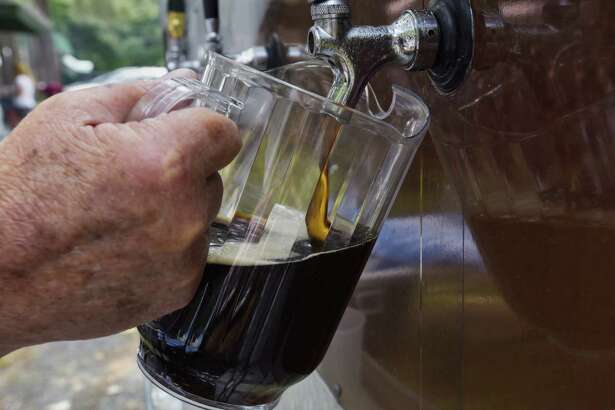 A pitcher of Optimator dark beer is poured at a picnic at the German-American Club of Albany on Sunday, August 19, 2018, in Albany, N.Y. (Paul Buckowski/Times Union)