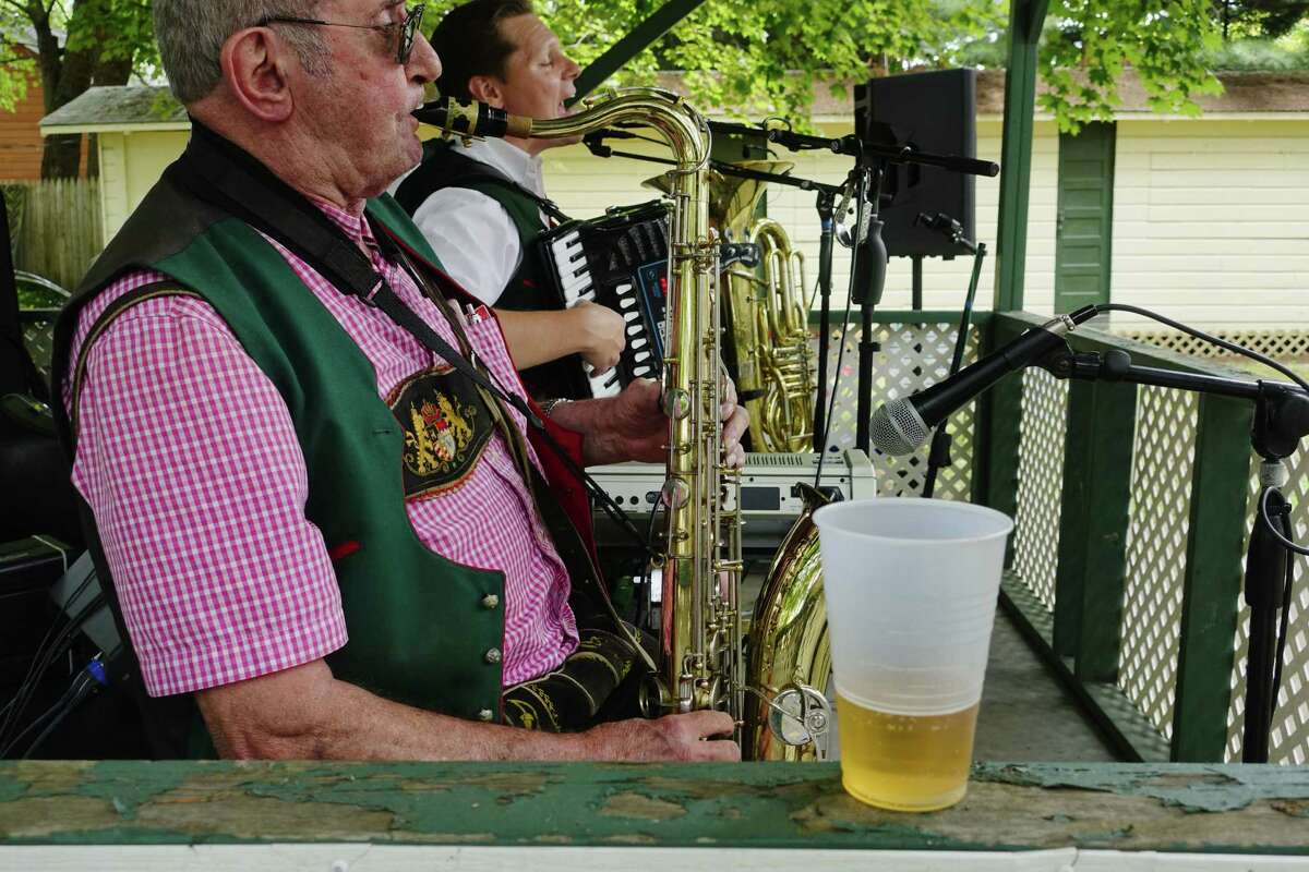 Vic Meister, foreground, and Gregory Reinwald, background, members of the Greg and the Brauhaus Band, perform during a picnic at the German-American Club of Albany on Sunday, August 19, 2018, in Albany, N.Y. (Paul Buckowski/Times Union)