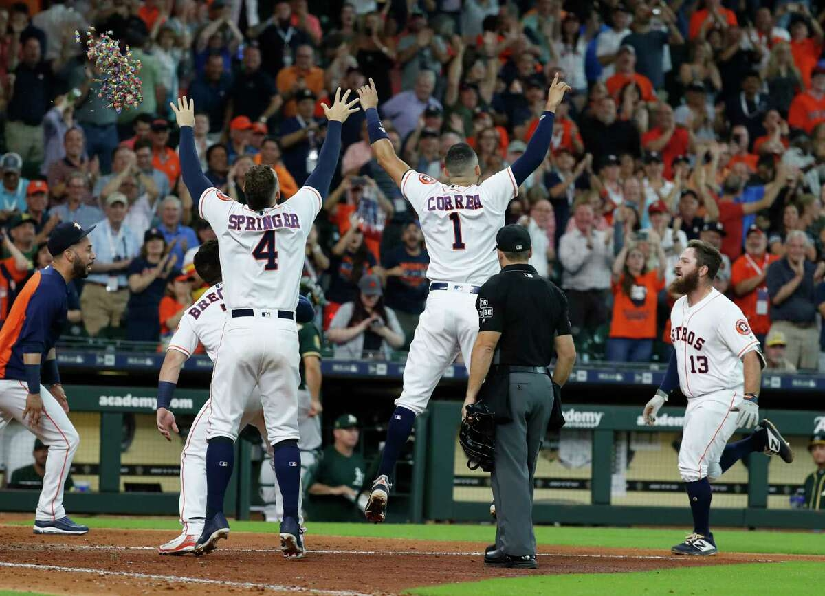 Houston Astros Tyler White (13) comes come to celebrate with teammates after hitting a walk-off home run during the ninth inning to win the game 5-4 against the Oakland Athletics during an MLB baseball game at Minute Maid Park, Wednesday, August 29, 2018, in Houston.