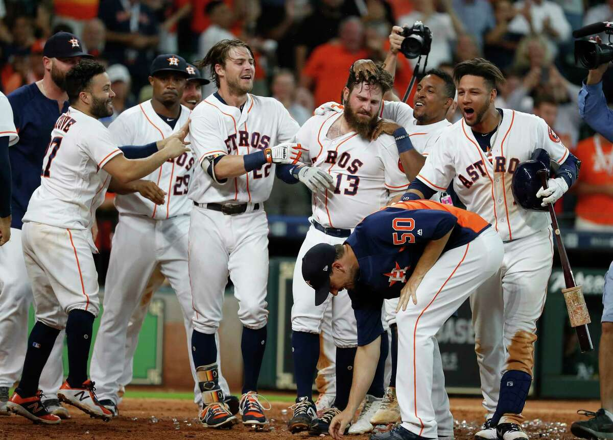 Houston Astros Tyler White (13) celebrates with teammates after hitting a walk-off home run during the ninth inning to win the game 5-4 against the Oakland Athletics during an MLB baseball game at Minute Maid Park, Wednesday, August 29, 2018, in Houston.