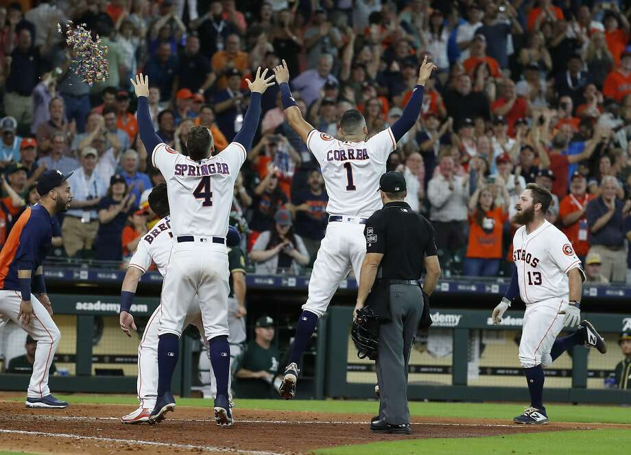 Houston Astros Tyler White (13) comes come to celebrate with teammates after hitting a walk-off home run during the ninth inning to win the game 5-4 against the Oakland Athletics during an MLB baseball game at Minute Maid Park, Wednesday, August 29, 2018, in Houston. Photo: Karen Warren, Staff Photographer