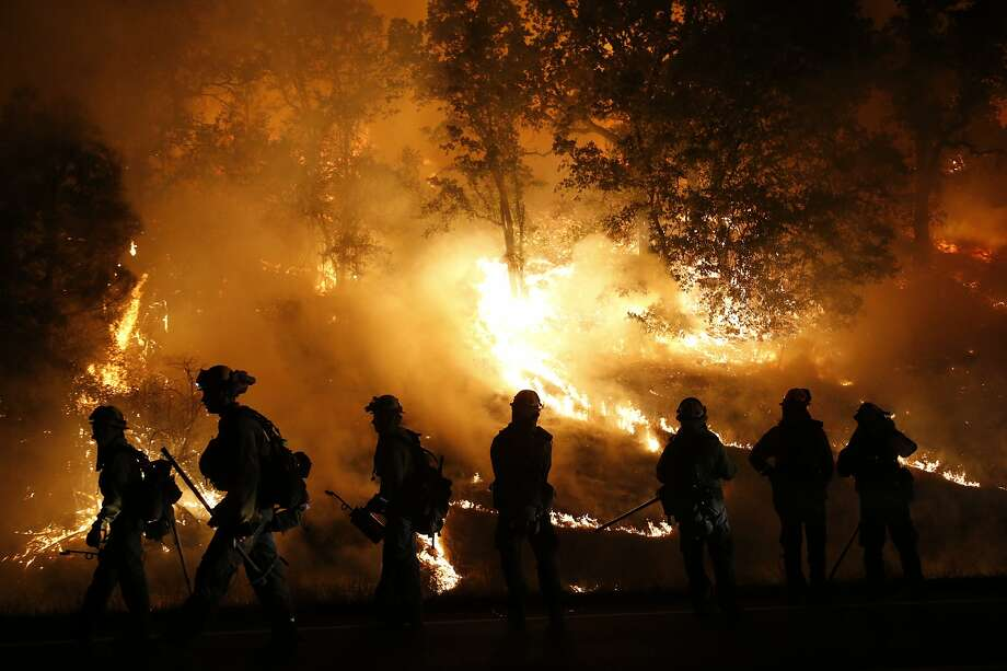 MIDDLETOWN, CA - SEPTEMBER 13: Firefighters with the Marin County Fire Department's Tamalpais Fire Crew monitor a backfire as they battle the Valley Fire on September 13, 2015 near Middletown, California. The fast-moving fire has consumed 50,000 acres aft Photo: Stephen Lam, Getty Images