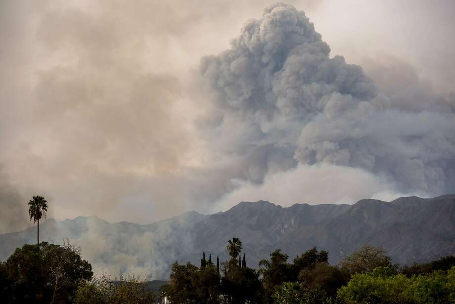 Smoke from the Thomas Fire in Santa Barbara looms over Ojai in Ventura County that killed two people. The cause of that fire is still under investigation. Photo: Hilary Swift / New York Times 2017