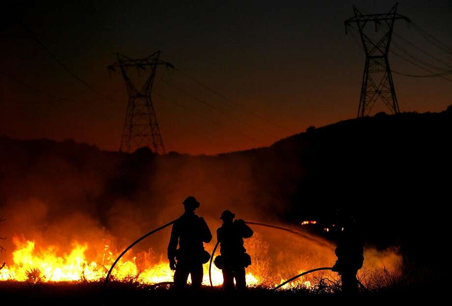 Los Angeles County firefighters mop up hot spots as they fight the Station Fire in Acton that was started by an arsonist in 2009. Photo: Justin Sullivan / Getty Images 2009