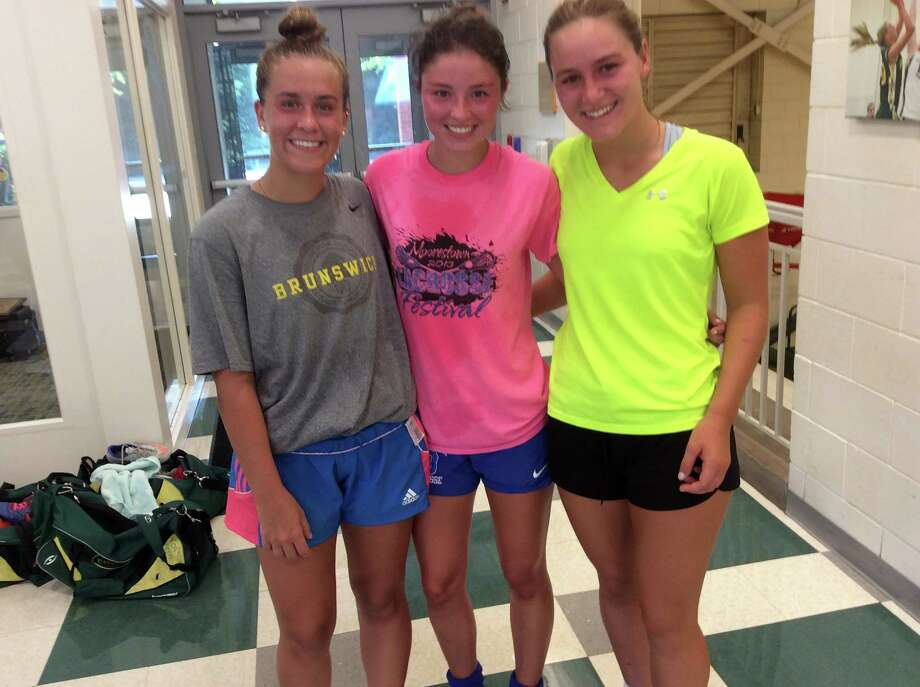 From left to right, Daisy Stuart, Olivia DeGulis and Karina Toub are senior captains on the Greenwich Academy soccer team, which has won the FAA Tournament title the past two seasons. August, 29, 2018 Photo: David Fierro / Hearst Connecticut Media / Contributed Photo / Greenwich Time Contributed