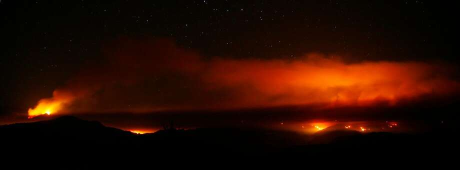 The Zaca Fire, burning in the mountains north of Santa Barbara, illuminates the smoke covering the mountaintop while a smaller fire descends toward rural homes, ranches and campgrounds as seen in this time-lapse exposure from 2007. Photo: Michael A. Mariant / Associated Press 2007