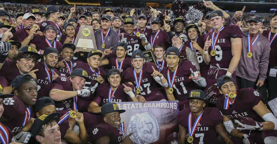 PHOTOS: All-Greater Houston preseason football Cy-Fair coaches and players pose for a photo with the state title plaque after winning the Class 6A Division II State Championship Game at AT&T Stadium on Saturday, Dec. 23, 2017, in Arlington. The Cy-Fair Bobcats defeated the Waco Midway Panthers 51-35 and won the state championship title. The program begins the defense of its state title on Friday in the season opener against The Woodlands. ( Yi-Chin Lee / Houston Chronicle ) Check out the slideshow to see the First Team Offense for the All-Greater Houston preseason football team. Photo: Yi-Chin Lee/Houston Chronicle