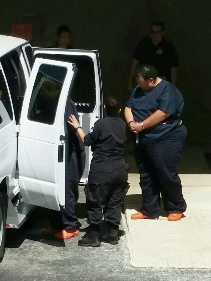 Mark Anthony Rodriguez, 52, loaded into a jail van outside the federal courthouse. Photo: Guillermo Contreras / Staff