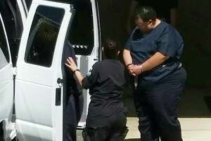 Mark Anthony Rodriguez, 52, loaded into a jail van outside the federal courthouse.