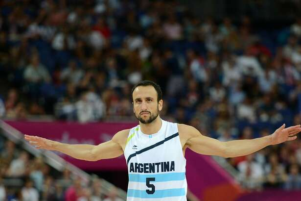 """(FILES) In this file picture taken on August 10, 2012 Argentinian guard Emanuel Ginobili is pictured during the London 2012 Olympic Games men's semifinal basketball game against USA at the North Greenwich Arena in London. - San Antonio Spurs star Manu Ginobili confirmed his retirement from basketball on August 27, 2018, bringing down the curtain on a 23-year career that included four NBA Finals victories. The 41-year-old Argentine star, widely seen as the most successful foreign player in the history of the NBA, confirmed his retirement in a brief posting on social media. """"Today, with a wide range of feelings, I'm announcing my retirement from basketball,"""" Ginobili wrote. (Photo by Timothy A. CLARY / AFP)TIMOTHY A. CLARY/AFP/Getty Images"""