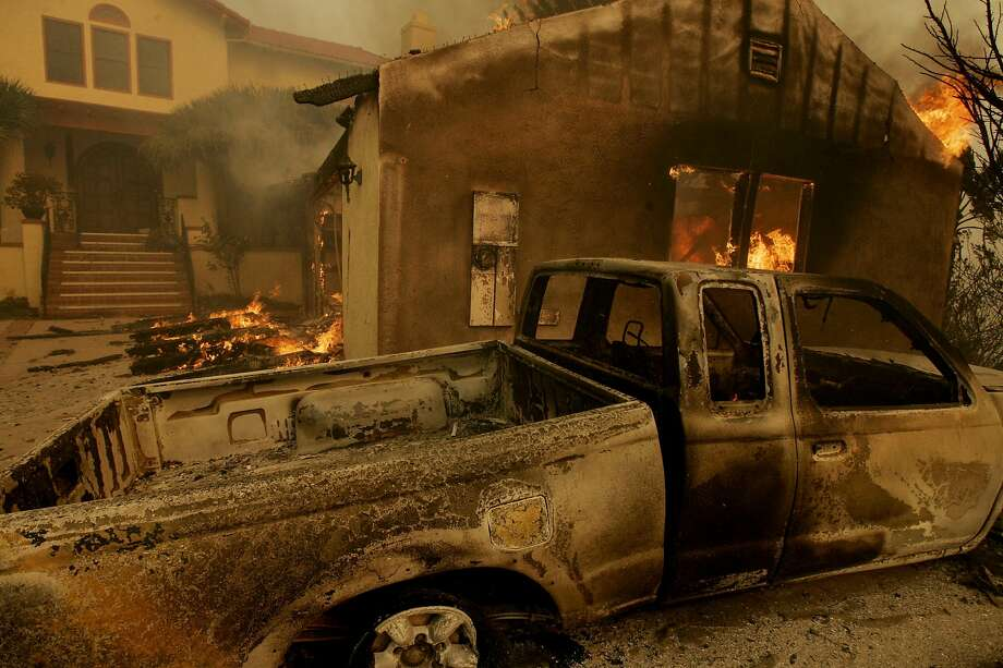 POWAY, CA - OCTOBER 22:  A house burns due to a massive brush fire October 22, 2007 in Poway, California.  The Witch Fire, which started outside of Ramona, California, has burned hundreds of structures and forced thousands of evacuations as fires burn acr Photo: Sandy Huffaker / Getty Images 2007