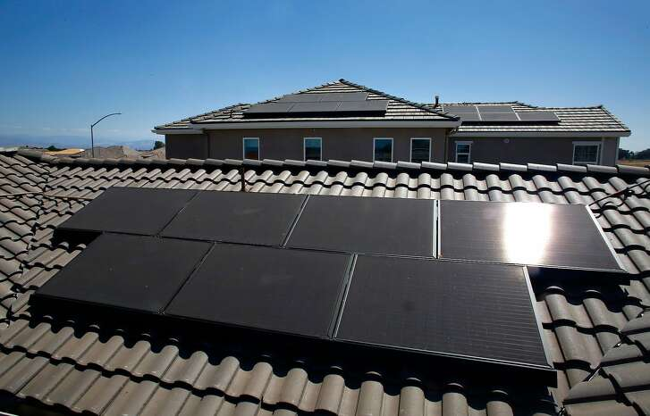 Solar panels are installed on the roofs of zero energy model homes, as seen on Thurs. May 17, 2018 in Clovis, Ca. The EnVision planned community, by De Young properties is the first of it's kind in Central California and largest in the State of California.